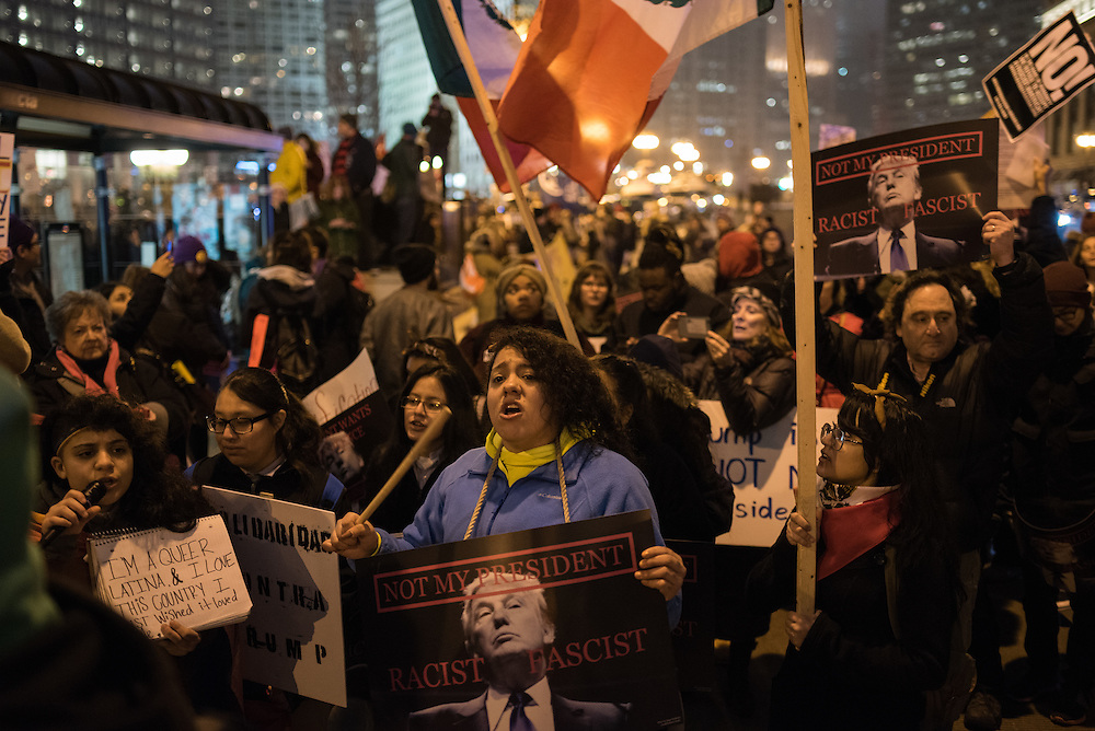 """Racist, sexist, anti-gay! Donald Trump, go away!"" a crowd chants outside of Trump Tower in downtown Chicago on Inauguration Day, January 20, 2017."
