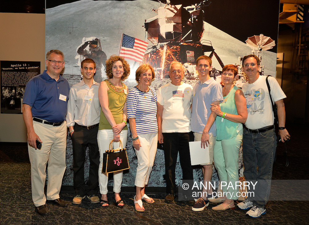 ROBERT BOTWIN, of Bellmore, at center wearing shirt with American Flag, is with his wife SHELLY BOTWIN and their children and grandchildren at a Summer of '69 Celebration Event, the reunion of former Northrop Grumman Aerospace Corporation employees, held at the Long Island Cradle of Aviation Museum, on the 45th Anniversary of NASA Apollo 11 LEM landing on the moon. Mr. Botwin was the LEM ascent and descent propulsion systems Director. The three generations of the Botwin family were standing in front of a large photo of the July 20, 1969 lunar landing.