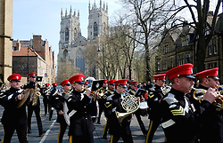 © Licensed to London News Pictures. 21/04/2014<br /> <br /> York, United Kingdom<br /> <br /> The band of the Royal Armoured Corps march through the streets of York ahead of an Artillery gun salute from 4th Regiment Royal Artillery who fired a salute in the Museum Gardens in York to mark the Queen's 88th birthday. <br /> <br /> Three 105mm light guns from the Topcliffe based regiment fired 21 rounds to mark the occasion.<br /> <br /> Photo credit : Ian Forsyth/LNP