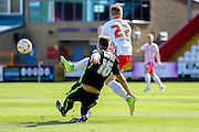 York City defender Dave Winfield tackles Stevenage Midfielder Charlie Lee during the Sky Bet League 2 match between Stevenage and York City at the Lamex Stadium, Stevenage, England on 12 September 2015. Photo by Simon Davies.