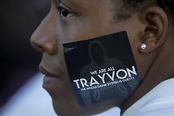 60133348  <br /> A protester is seen with a sticker showing the name of Trayvon Martin on the face during a demonstration to protest George Zimmerman s acquittal in the shooting death of Florida teen Trayvon Martin, in Los Angeles, California, July, 15, 201. A Jury in U.S. state Florida on July 13 acquitted George Zimmerman, who shot and killed Seventeen-year-old African American teenager Trayvon Martin on Feb. 26, 2012, in a case which sparked heated debate on race and guns, Los Angeles, USA,<br /> Monday, 15th July 2013<br /> Picture by imago / i-Images<br /> UK ONLY