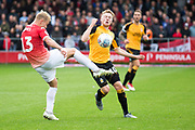 Salford City midfielder Sam Hughes challenged by Cambridge United forward George Maris during the EFL Sky Bet League 2 match between Salford City and Cambridge United at Moor Lane, Salford, United Kingdom on 12 October 2019.