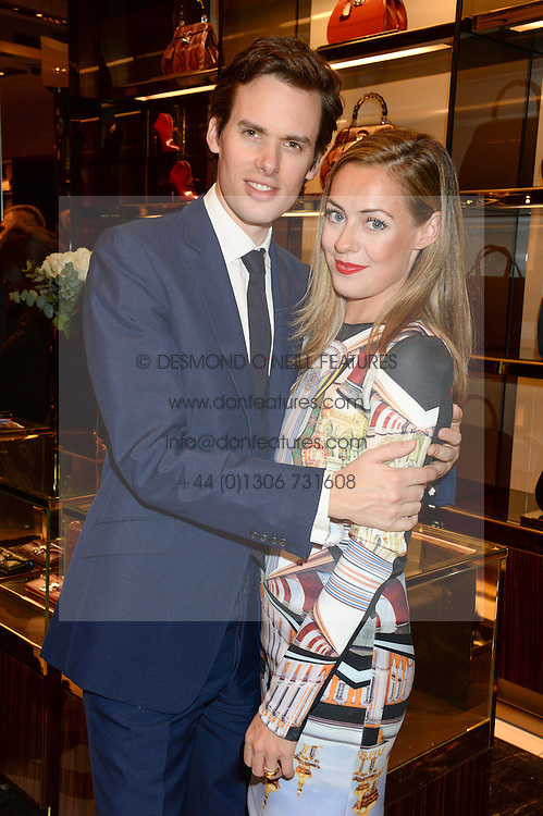 The HON.RAOUL FRASER & his wife CAT FRASER at a party hosted by Gucci & Clara Paget to drink a new cocktail 'I Bamboo You' held at Gucci, 34 Old Bond Street, London on 16th October 2013.