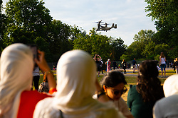 Muslim women watch one of the Osprey aircraft that accompany Trump landing as protesters create a big noise in Regent's Park, London, outside the US Ambassador's residence where President Donald Trump is staying. London, July 12 2018.