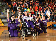 Keslie Levad (white Sparkle jersey) performs at an assembly in front of the entire student body at Arvada West High School.
