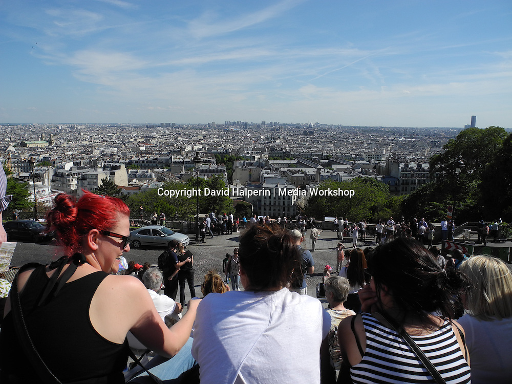 Paris skyline with tourists, looking out from Sacre Coeur cathedral from top of Montmartre
