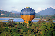 Sri Lanka..Balloon flying above Kandalama tank, near the Kandalama hotel which can just be seen in the background.