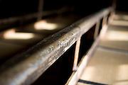 Photo shows a worn handrail inside the Korakukan theater, Japan's oldest extant wooden playhouse in Kosaka, Akita Prefecture Japan on 19 Dec. 2012. Made entirely from wood, the theater was opened in 1910 and was registered as an Important Cultural Property in 2007. Photographer: Robert Gilhooly