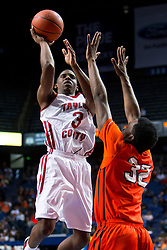 Taylor County guard Quentin Goodin, left, shoots over Hopkinsville forward Jaqualis Matlock in the second half. <br /> Taylor County hosted Hopkinsville in game two of the 2015 KHSAA Boy's Sweet 16 Tournament, Wednesday, March 18, 2015 at Rupp Arena in Lexington. <br /> <br /> Photo by Jonathan Palmer