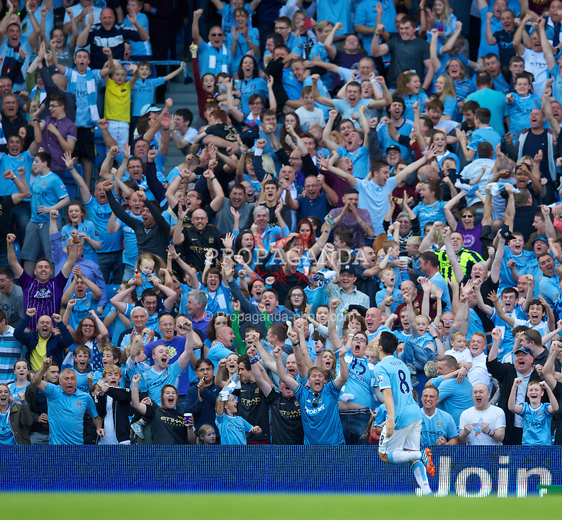 MANCHESTER, ENGLAND - Sunday, September 22, 2013: Manchester City's Samir Nasri celebrates scoring the fourth goal against Manchester United during the Premiership match at the City of Manchester Stadium. (Pic by David Rawcliffe/Propaganda)