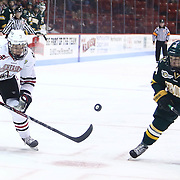 Mike McMurtry #7 of the Northeastern Huskies and Chris Muscoby #24 of the Vermont Catamounts skate to the puck during the game at Matthews Arena on January 18, 2014 in Boston, Massachusetts. (Photo by Elan Kawesch)