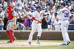 August 17, 2017 - Chicago, IL, USA - The Chicago Cubs' Javier Baez celebrates with teammate Mike Montgomery (38) after hitting a home run during the fourth inning against the Cincinnati Reds at Wrigley Field in Chicago on Thursday, Aug. 17, 2017. The Reds won, 13-10. (Credit Image: © Armando L. Sanchez/TNS via ZUMA Wire)