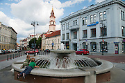 Children play in the water fountain at City Hall Square/Plaza, Senamiestas, Vilnius, Lithuania