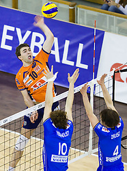 Uros Kovacevic of ACH Volley vs Wauter Verhelist and Stjin D'Hulst Ruben Van Hirtum of Knack Roeselare during volleyball match between ACH Volley (SLO) and Knack Roeselare (BEL) at Quarterfinals of CEV Challenge Cup 2011/2012, on February 8, 2012 in Arena Tivoli, Ljubljana, Slovenia. ACH Volley defeated Knack Roeselare 3-0. (Photo By Grega Valancic / Sportida.com)