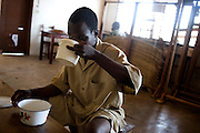 February 2008 - student at the  School for the Blind drinking in the classroom in Cotonou, Benin. The School takes 80 blind students surrounding villages and at no cost to their families teaches them geography, science, math and a work for the future. Though the school belongs to the state, it receives considerable funding from ONG.