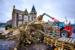Biggar, South Lanarkshire, Scotland 11th December 2016 ::  Building the biggest hogmanay bonfire in Britain! The Biggar hogmanay bonfire in the High Street is started on the 1st December each year and the build continues throughout the month until it is set alight on 31st December at 9.30pm  One of many fire festivals in Scotland.<br /> <br /> (c) Andrew Wilson | Edinburgh Elite media
