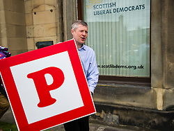 Pictured: Willie Rennie dying for a p<br /> <br /> Scottish Liberal Democrat leader Willie Rennie made his final pitch for votes today as he unveiled large building blocks that spelt out the party's flagship &quot;Penny for education&quot; policy. Scottish Liberal Democrats HQ, 4, EH12 5DR. Adam Clarke 07450 980 386.the election on Thursday.<br /> <br /> Ger Harley | EEm 2 May 2016