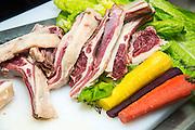 Chef prepares and cuts lamb ribs