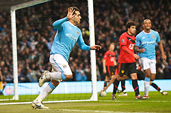 MANCHESTER, ENGLAND - Tuesday, January 19, 2010: Manchester City's Carlos Tevez celebrates scoring the second goal against Manchester United during the Football League Cup Semi-Final 1st Leg at the City of Manchester Stadium. (Photo by David Rawcliffe/Propaganda)