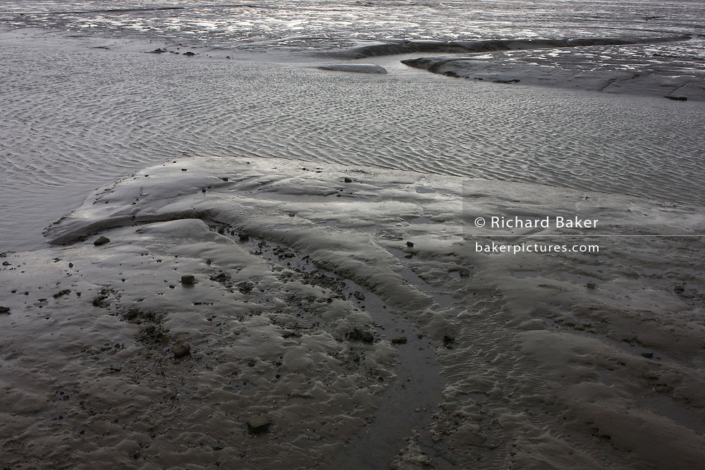 A wide landscape of mudflats at low-tide at Leigh-on-sea, Essex.