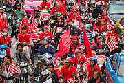 "10 DECEMBER 2012 - BANGKOK, THAILAND: Red Shirt protestors mass on Petchaburi Rd in Bangkok near the offices of the ruling Pheu Thai party Monday to call for constitutional reform. The Thai government announced on Monday, which is Constitution Day in Thailand, that will speed up its campaign to write a new charter. December 10 marks passage of the first permanent constitution in 1932 and Thailand's transition from an absolute monarchy to a constitutional monarchy. Several thousand ""Red Shirts,"" supporters of ousted and exiled Prime Minister Thaksin Shinawatra, motorcaded through the city, stopping at government offices and the offices of the Pheu Thai ruling party to present demands for a new charter.         PHOTO BY JACK KURTZ"