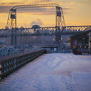 Boardwalk along the Foss Waterway on a snowy morning, with the Murray Morgan Bridge in the background - Tacoma, WA