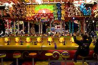 Girl Celebrating Win at Rising Waters Carnival Game at L.A. County Fair, Pomona, California