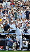 New York Yankees Derek Jeter waves to the cheers of the crowd after he hit a solo home run for his 3000th career hit in the third inning of a baseball game on Saturday, July 9, 2011 at Yankee Stadium in New York. (AP Photo/Kathy Kmonicek)