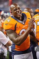 28 AUG 2014: Denver Broncos defensive end DeMarcus Ware (94) laughs on the sideline during the final NFL American Football Herren USA preseason game between the Denver Broncos and Dallas Cowboys at AT&T Stadium in Arlington, TX. NFL American Football Herren USA AUG 28 Preseason - Broncos at Cowboys PUBLICATIONxINxGERxSUIxAUTxHUNxRUSxSWExNORxONLY Icon140828695<br />