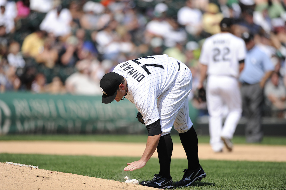 CHICAGO - JULY 06:  Will Ohman #77 of Chicago White Sox uses the rosin bag on the pitchers mound during the game against the Kansas City Royals on July 6, 2011 at U.S. Cellular Field in Chicago, Illinois.  The Royals defeated the White Sox 4-1.  (Photo by Ron Vesely)  Subject: Will Ohman