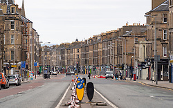 Edinburgh, Scotland, UK. 29 March, 2020. Life in Edinburgh on the first Sunday of the Coronavirus lockdown. Streets deserted, shops and restaurants closed, very little traffic on streets and reduced public transport. Pictured; Leith Walk is empty. Iain Masterton/Alamy Live News