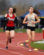 Katie Lembo of Penfield and Alex Cooper of Rush-Henrietta compete in the 1,500-meter run at the His and Her track and field invitational at Penfield High School on Saturday, April 26, 2014. Cooper won the event.