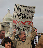 People hold signs against Obama's legislative programs at a Capitol Hill rally asking Senators to respect the will of the people in the Lame Duck Session sponsored by Americans for Prosperity on Novembee 15, 2010.  Photograph by Dennis Brack