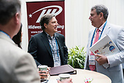 Jeff Rusinow from Silicon Pastures and Tom Still from Wisconsin Technology Council at the Wisconsin Entrepreneurship Conference at Venue 42 in Milwaukee, Wisconsin, Tuesday, June 4, 2019.
