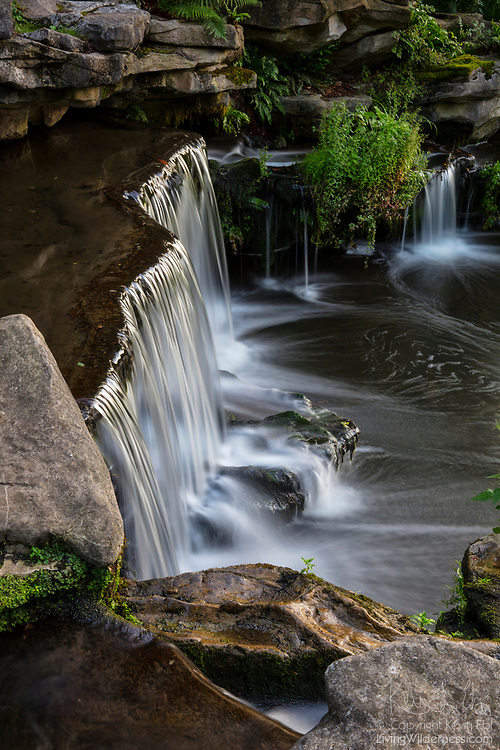 A waterfall known simply as Cascade or Waterval (respectively the French and Dutch words for waterfall) is a primary feature of Parc de Woluwé, a natural area near Brussels, Belgium.