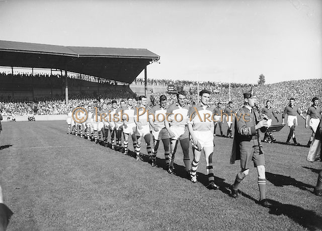 Players walk the pitch before the All Ireland Senior Gaelic Football Final, Down v. Offaly in Croke park on 24th September 1961.