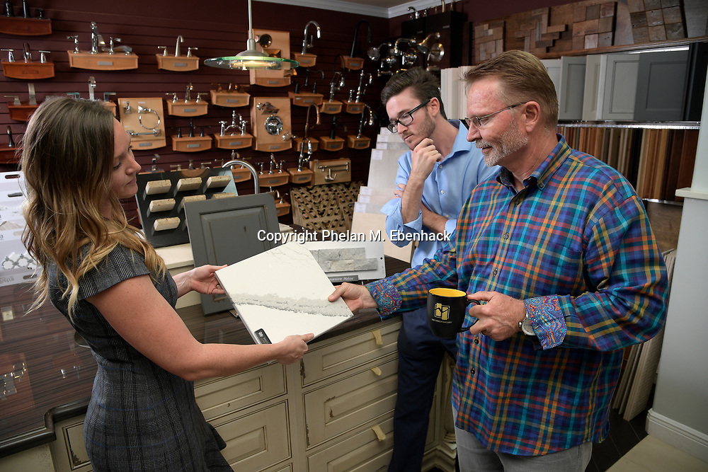 Keith Vellequette, right, owner and lead designer of KBF Design Gallery, talks about a project with family members Ashley, left, and Adam at their showroom Monday, Sept. 18, 2017, in Altamonte Springs, Fla. (Photo by Phelan M. Ebenhack)