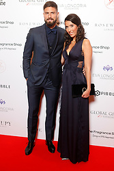 Olivier Giroud and Jennifer Giroud attending the 9th Annual Global Gift Gala held at the Rosewood Hotel, London.