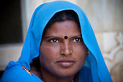Indian Hindu woman in traditional Rajasthani sari at The Amber Fort in Jaipur, Rajasthan, India
