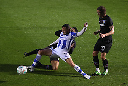 Colchester United's Drey Wright (front) and Aston Villa's Andre Green battle for the ball during the Carabao Cup, First Round match at the Weston Homes Community Stadium, Colchester.