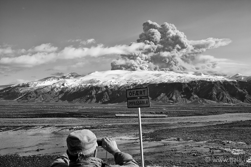 Volcanic eruption, Eyjafjallajokull, Iceland. Tourist taking picture of the mountain