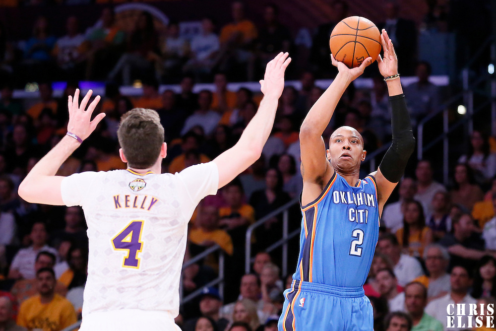 09 March 2014: Oklahoma City Thunder small forward Caron Butler (2) takes a jumpshot over Los Angeles Lakers center Pau Gasol (16) during the Los Angeles Lakers 114-110 victory over the Oklahoma City Thunder at the Staples Center, Los Angeles, California, USA.