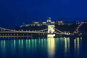 Budapests's famous Széchenyi Chain Bridge (1849) and the former royal residence, Buda Palace on Buda Hill  ..