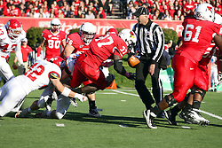 15 October 2011: Hit by Shea Williams, Darrelynn Dunn coughs up the ball during an NCAA football game between the University of South Dakota Coyotes and the Illinois State Redbirds (ISU) at Hancock Stadium in Normal Illinois.