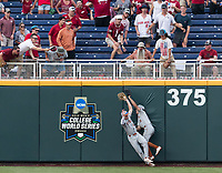 Texas' outfielders Austin Todd, left, and Tate Shaw collide while Todd catches a ball hit by Arkansas' Carson Shaddy in the eighth inning during game four of the College World Series at TD Ameritrade Park on Sunday, June 17, 2018.<br /> <br /> MATT DIXON/THE WORLD-HERALD