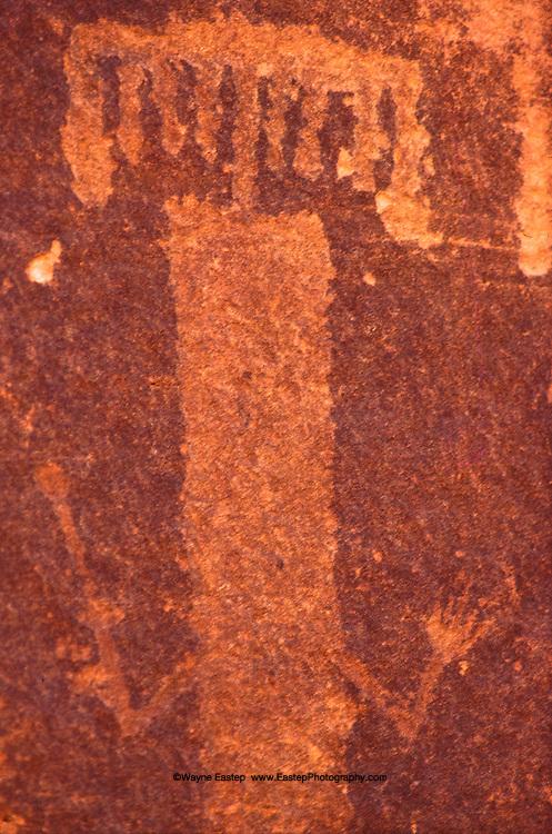 Incised style rock art representing a human dancing. Jebel Burnus, Saudi Arabia