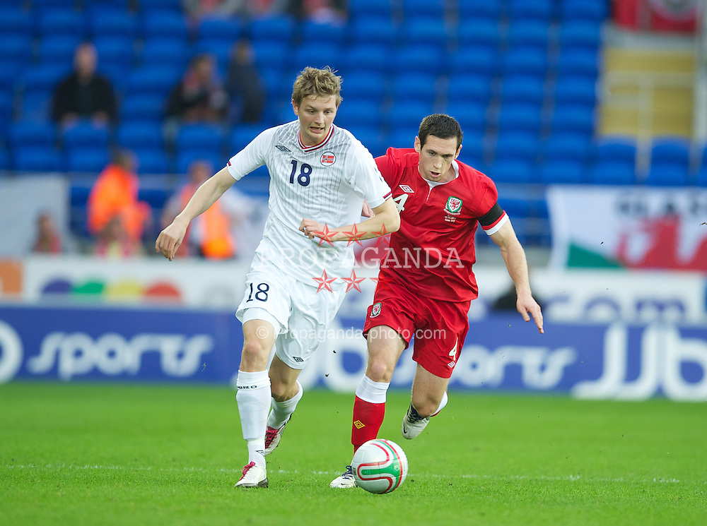 CARDIFF, WALES - Saturday, November 12, 2011: Wales' Andrew Crofts in action against Norway's Erik Huseklepp during the international friendly match at the Cardiff City Stadium. (Pic by David Rawcliffe/Propaganda)
