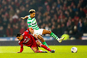Max Lowe (#29) of Aberdeen slides in to win the ball from Scott Sinclair (#11) of Celtic during the Betfred Cup Final between Celtic and Aberdeen at Celtic Park, Glasgow, Scotland on 2 December 2018.