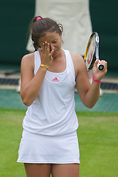 LONDON, ENGLAND - Monday, June 22, 2009: Laura Robson (GBR) looks dejected after her 6-3, 4-6, 2-6 defeat during the 1st Round of the Ladies' Singles on day one of the Wimbledon Lawn Tennis Championships at the All England Lawn Tennis and Croquet Club. (Pic by David Rawcliffe/Propaganda)