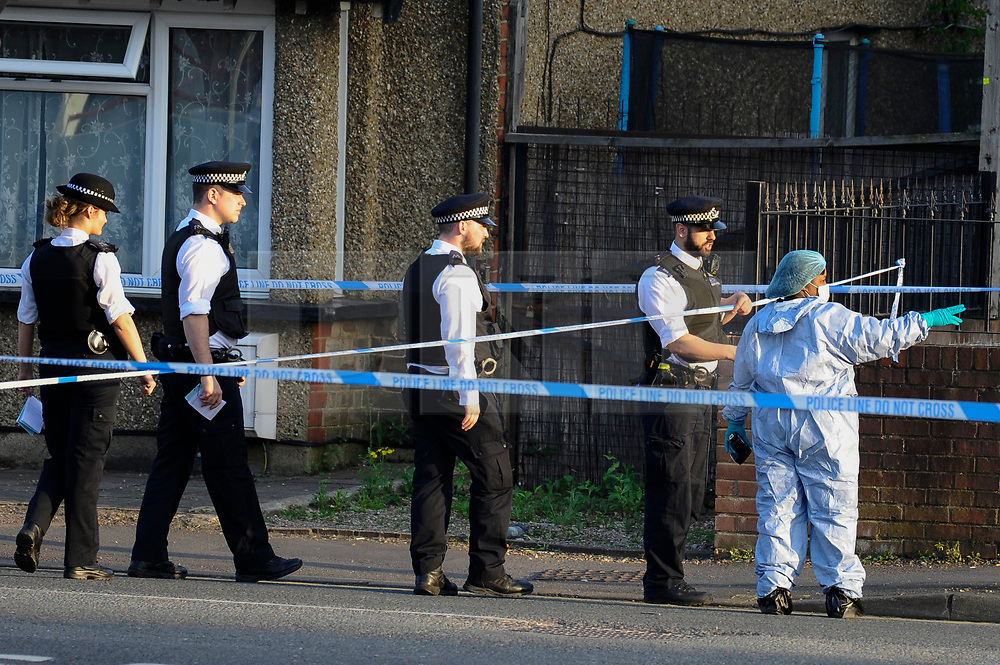 © Licensed to London News Pictures. 06/05/2018. LONDON, UK.  Police and a member of the forensics team at work inside the cordon on Palmerston Road in Wealdstone, near Harrow, north west London, following reports of two separate shooting incident around midday on Sunday 6 May 2018.  The two victims are a 12 year old boy and a15 year old boy.  Investigations are ongoing.  Photo credit: Stephen Chung/LNP